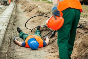 Man lying on the ground after an accident at a construction site