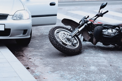 Motorcycle laying on the ground after an accident
